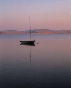 peaceful water with sailboat